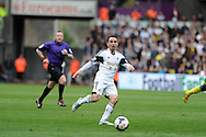 Swansea city's Leon Britton in action. Barclays premier league match , Swansea city v Norwich city at the Liberty stadium in Swansea, South Wales on Saturday 29th March 2014.<br /> pic by Andrew Orchard,  Andrew Orchard sports photography.<br /> contact and payments to Andrew Orchard, 2 Old Vicarage close,