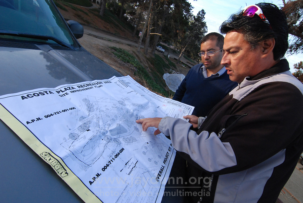 Luis Ortega, right, construction superintendent for CHISPA, and Joel Hernandez of the Center for Community Advocacy check the plans on Tuesday morning, October 27th, for the Acosta Plaza Recreation Area project in east Salinas, CA.