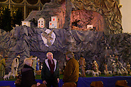 Tom Rafferty of Kettering (right) in front of the large historic nativity at St. Mary Catholic Church in Dayton, Tuesday, December 27, 2011.  Rafferty came to photograph the nativity and show it to his wife Sharleen (not in picture) who, though she's heard him talk about it, hadn't seen the display before.