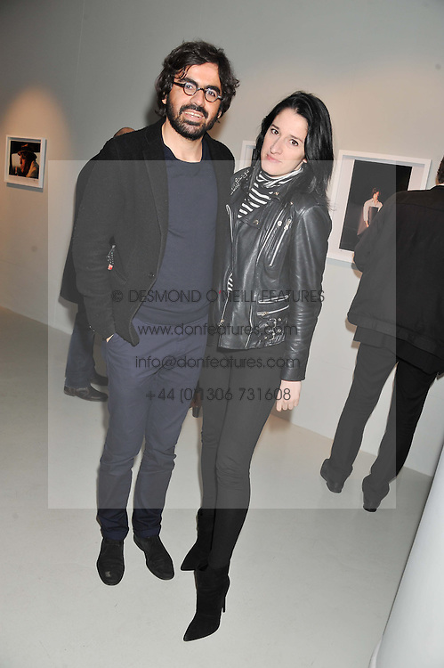 AMY MOLYNEAUX and LAURENT BENHAMOU at a private view of Bill Wyman - Reworked held at the Rook & Raven Gallery, 7 Rathbone Place, London W1 on 26th February 2013.