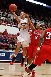 March 19, 2011; Stanford, CA, USA; Texas Tech Lady Raiders guard Casey Morris (15) shoots past St. John's Red Storm guard Nadirah McKenith (5) during the second half of the first round of the 2011 NCAA women's basketball tournament at Maples Pavilion. St. John's defeated Texas Tech 55-50.