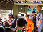 19 MARCH 2015 - AYUTTHAYA, AYUTTHAYA, THAILAND:   On the third class train from Ayutthaya to Bangkok. The train line from Bangkok to Ayutthaya was the first rail built in Thailand and was opened in 1892. The State Railways of Thailand (SRT), established in 1890, operates 4,043 kilometers of meter gauge track that reaches most parts of Thailand. Much of the track and many of the trains are poorly maintained and trains frequently run late. Accidents and mishaps are also commonplace. Successive governments, including the current military government, have promised to upgrade rail services. The military government has signed contracts with China to upgrade rail lines and bring high speed rail to Thailand. Japan has also expressed an interest in working on the Thai train system. Third class train travel is very inexpensive. Many lines are free for Thai citizens and even lines that aren't free are only a few Baht. Many third class tickets are under the equivalent of a dollar. Third class cars are not air-conditioned.   PHOTO BY JACK KURTZ
