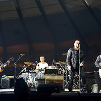 Picture By: Drew Farrell / Retna Pictures .Picture shows : (l-r) The Edge, Larry Mullen Jr, Bono and Adam Clayton performing during The U2 360° Tour  at Hampden Park, Glasgow, Scotland. Tuesday August 18th, 2009 . * Non-Exclusive World Rights * .*Unbylined uses will incur an additional discretionary fee!*....