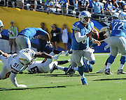 September 13, 2015 - San Diego Chargers Defensive End Kendall Reyes (91) [17645] sends Detroit Lions Quarterback Matthew Stafford (9) [11316] on the run during the NFL football game between the San Diego Chargers and the Detroit Lions at Qualcomm Stadium in San Diego, California.