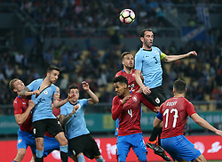 NANNING, March 23, 2018  Diego Godin (Top) of Uruguay heads for the ball during the match between Uruguay and the Czech Republic at the 2018 China Cup International Football Championship in Nanning, capital of south China's Guangxi Zhuang Autonomous Region, March 23, 2018. Uruguay won 2-0.  dx) (Credit Image: © Cao Can/Xinhua via ZUMA Wire)