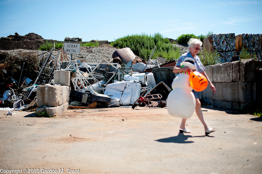 Shelter Island, NY - 7/5/10 - Joan McVeigh of Shelter Island leaves the scrap waste area of the Shelter Island Town Recycling Center with items on Shelter Island, NY, July 5, 2010. CREDIT: Gordon M. Grant for The Wall Street Journal.