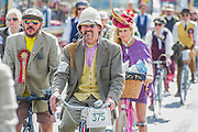 "The Tweed Run 2015 - it's 7th annual British public bicycle ride through London's historic streets, with a prerequisite that participants are dressed in their best tweed cycling attire. There are also plenty of handle bar moustaches, penny farthings and Union Jacks. ""Guests can expect a leisurely day cycling, stopping at some of London's most iconic landmarks to enjoy a spot of tea, a picnic in the park and finally a jolly good knees-up in a beautiful art-deco ballroom for the Tweed Run closing ceremony. Starting at Trafalgar Square, the cyclists then embarked on a 12 mile scenic ride through London, stopping at traditional spots."