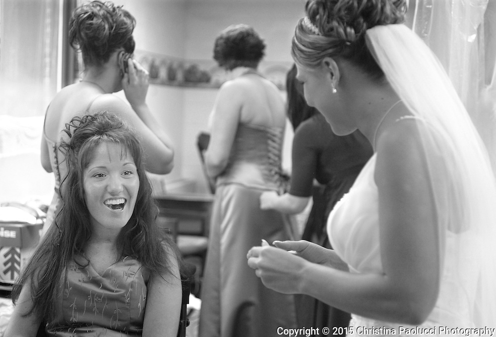 Brooke in the dressing room with the bridesmaid and bride, Jessica Fate.  Fate had been Brooke's personal care assistant before getting married and moving to Fargo. (Rochester Post-Bulletin, Christina Paolucci)