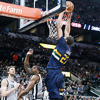 02 April 2017: Utah Jazz center Rudy Gobert (27) goes for the dunk on San Antonio Spurs forward Kawhi Leonard (2) during the San Antonio Spurs 109-103 victory over the Utah Jazz, at the AT&T Center, San Antonio, Texas, USA.