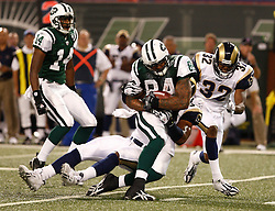 Aug 14, 2009; East Rutherford, NJ, USA;   New York Jets defensive tackle Kareem Brown (84) is tackled during the second half at Giants Stadium. The Rams defeated the Jets 23-20.