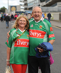 Mayo supporters Geraldine and Manus O'Donnell from Ballycroy on their way to the Croke park for the All Ireland quarter final replay<br /> Pic Conor McKeown