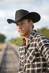 cowboy near a railroad track