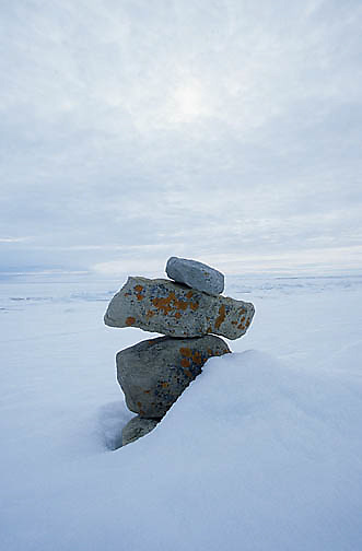 Canada, Nunavut Territory, Inukshuk, or Inuit landmarks along shores of the town of Igloolik.