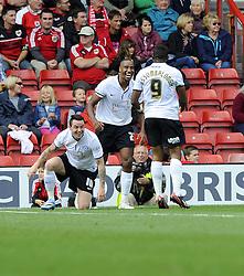 Peterborough United's Tyrone Barnett celebrates his goal with Peterborough United's Britt Assombalonga and Peterborough United's Lee Tomlin  - Photo mandatory by-line: Joe Meredith/JMP - Tel: Mobile: 07966 386802 14/09/2013 - SPORT - FOOTBALL -  Ashton Gate - Bristol - Bristol City V Peterborough United - Sky Bet League One