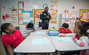 Students learn about law enforcement for Harris County Sheriff's Department lieutenant Marcus Kinnard-Bing during Career Day at Foster Elementary School, March 14, 2014.