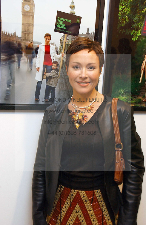 Actress AMANDA MEALING at an exhibition of photographs entitled 'Protect The Human' by photographers Jake Gavin and Sean Gleason commissioned by Amnesty Internationlal and held at The Hospital, 24 Endell Street, London WC2 on 31st May 2006.<br />