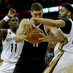 Jan 20, 2017; New Orleans, LA, USA; Brooklyn Nets center Brook Lopez (11) is defended by New Orleans Pelicans forward Anthony Davis (23) during the second half of a game at the Smoothie King Center. The Nets defeated the Pelicans 143-114. Mandatory Credit: Derick E. Hingle-USA TODAY Sports