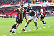 Sheffield United midfielder Lee Evans (20) and Millwall FC defender James Meredith (3)during the EFL Sky Bet Championship match between Sheffield United and Millwall at Bramall Lane, Sheffield, England on 14 April 2018. Picture by Ian Lyall.