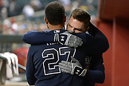 PHOENIX, AZ - JULY 26:  Matt Kemp #27 and Freddie Freeman #5 of the Atlanta Braves hug in the dugout during the MLB game against the Arizona Diamondbacks at Chase Field on July 26, 2017 in Phoenix, Arizona.  (Photo by Jennifer Stewart/Getty Images)