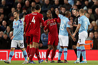 Football - 2019 / 2020 Premier League - Liverpool vs. Manchester City<br /> <br /> Georginio Wijnaldum of Liverpool and Fernandinho of Manchester City clash, at Anfield.<br /> <br /> COLORSPORT/PAUL GREENWOOD