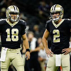 Aug 31, 2017; New Orleans, LA, USA; New Orleans Saints quarterback Garrett Grayson (18) and quarterback Ryan Nassib (2) before a preseason game against the Baltimore Ravens at the Mercedes-Benz Superdome. Mandatory Credit: Derick E. Hingle-USA TODAY Sports
