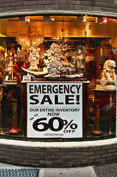 """Emergency sale"" sign in store window, Midtown Manhattan, NY, US"