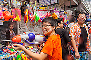 "13 APRIL 2013 - BANGKOK, THAILAND:  Thais and foreign tourists participate in water fights up and down Khao San Road, which is Bangkok's ""backpacker"" district, during Songkran celebrations in the Thai capital. Songkran is celebrated in Thailand as the traditional New Year's Day from 13 to 16 April. The date of the festival was originally set by astrological calculation, but it is now fixed. If the days fall on a weekend, the missed days are taken on the weekdays immediately following. Songkran is in the hottest time of the year in Thailand, at the end of the dry season and provides an excuse for people to cool off in friendly water fights that take place throughout the country. Songkran has been a national holiday since 1940, when Thailand moved the first day of the year to January 1.   PHOTO BY JACK KURTZ"