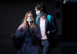 © Licensed to London News Pictures. 15/06/2020. London, UK. Commuters at Victoria Station in London wearing face masks, on the day the the easing of lockdown rules means all passengers must wear face masks. Government has introduced further measures to allow non-essential shops and services to reopen under social distancing conditions. Photo credit: Ben Cawthra/LNP