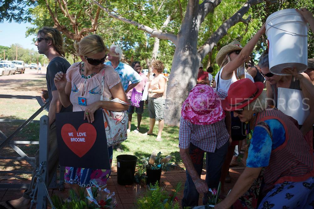 Broome's Community offering flowers to Broome Police Station ,Broome,WA.2012 @Ingetje Tadros www.ingetjetadros.com