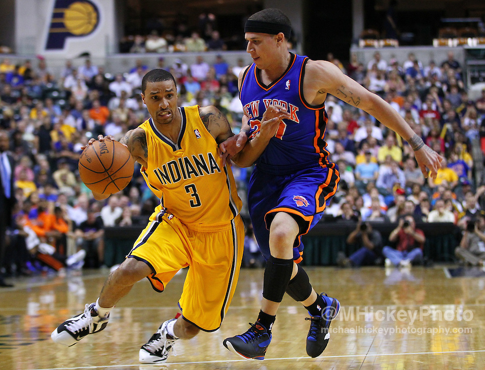 April 03, 2012; Indianapolis, IN, USA; Indiana Pacers shooting guard George Hill (3) dribbles against New York Knicks point guard Mike Bibby (20) at Bankers Life Fieldhouse. Mandatory credit: Michael Hickey-US PRESSWIRE