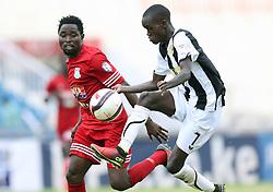 Bonface Muchiri of Tusker FC challenges Simon Mbugua of Posta Rangers during their Sportpesa Prmier League tie match at the Nyayo Stadium Nairobi on the 2 August 2017. Photo/ Fredrick Omondi/www.Piccentre.com (KEN)