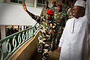 "Guinea president Captain Moussa Dadis Camara waves to a crowd of students gathered at the Kofi Annan private university in Conakry, Guinea on Thursday March 5, 2009. Camara, who took power after a coup in December 2008, was visiting the university to ""meet the youth"", as part of his efforts to solidify his support from Guinea's population.(Olivier Asselin for the New York Times)"