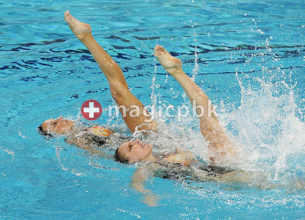 Belinda Schmid (R) and Magdalena Brunner (L) of Switzerland compete in the Duet Free Routine Preliminary at the synchronized swimming event during the Athens 2004 Summer Olympic Games at the Olympic Aquatic Centre on Tuesday 24 August 2004, in Athens, Greece. (Photo by Patrick B. Kraemer / MAGICPBK)