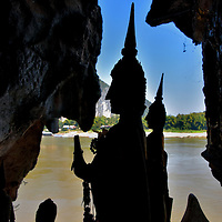 Silhouettes of Buddhist Statues at Pak Ou Caves in Ban Pak Ou, Laos<br />