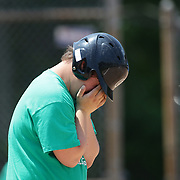 A batter shows emotion at first base after a hit during the Norwalk Little League baseball 'Champions' team V Greenwich in the Challenger Division  Recognition Day competition. The day acknowledged the many talents of the great players on the Challenger Division teams. The division has weekly games and practices for kids with special needs. Challenger division are held throughout the country.  Broad River Fields, Norwalk, Connecticut. USA. 2nd June 2013. Photo Tim Clayton