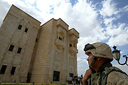 US Marine SGT. Eduardo Alvarez, of Hacienda HTS, CA, stands outside an entrance of ONE OF THE AREAS SECURED BY THE MARINES TODAY IN TIKRIT. The Lavish Palace secured by Marines in Tikrit believed to be one of Sadams many extravagant Homes. Marines moved into the region with some resistance.