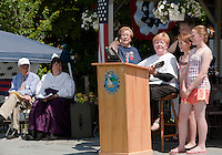 Jane Ellis performs the Gilford Bicentennial Song during the festivities held Saturday morning at Village Field.  (Karen Bobotas/for the Laconia Daily Sun)