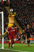 Football - 2019 / 2020 UEFA Champions League - Round of Sixteen, Second Leg: Liverpool (0) vs. Atletico Madrid (1)<br /> <br /> Atletico Madrid goalkeeper Jan Oblak jumps high above Liverpool's James Milner  to clear the ball, at Anfield.<br /> <br /> <br /> COLORSPORT/TERRY DONNELLY