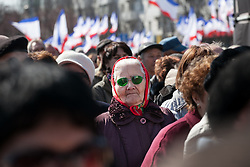 Crimea one day before the referendum. A lady attending a pro Russian rally with Crimean flags in the background at Simferopol's Lenin Square. Simferopol, . Saturday, 15th March 2014. Picture by Daniel Leal-Olivas / i-Images