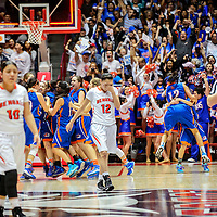 031215  Adron Gardner/Independent<br /> <br /> Gallup Bengals Tilea Reyna (15), left, Deerae Torrez (10) and Kristen Quigley (12) leave the court as the Los Lunas Tiger celebrate their 5A New Mexico state basketball tournament championship at The Pit in Albuquerque Thursday.