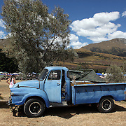 A vintage Ute parked by the side of the race meeting during the 50th Anniversary Glenorchy Race meeting. The races, which originally started in the 1920's, were resurrected in 1962 and have been run by local farmers and the rugby club on the first Saturday after New Years Day ever since. Glenorchy, Otago, New Zealand. 7th January 2012