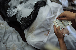 60360667 <br />  An Egyptian reads the Quran to mourn the dead ones at a mosque where lines of bodies wrapped in shrouds were laid out in Cairo, Egypt, August 15, 2013. At least 525 were killed and 3,717 others injured across Egypt in clashes between supporters of ousted President Mohamed Morsi and the security troops, after the latter dispersed Wednesday two major pro-Morsi sit-ins in Cairo and Giza, a Health Ministry official said Thursday, August 15, 2013. <br /> Picture by imago / i-Images<br /> UK ONLY