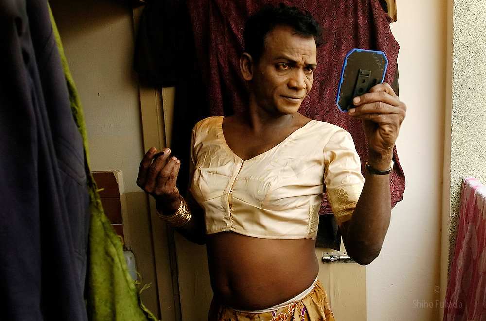 A transgender puts on makeup in Villupuram, India. <br />