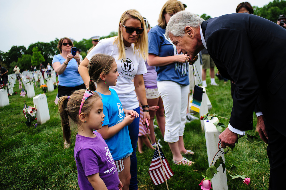 Secretary of Defense Chuck Hagel greets mourners during a Memorial Day visit to Arlington National Cemetery in Arlington Virginia, USA on 27 May, 2013.