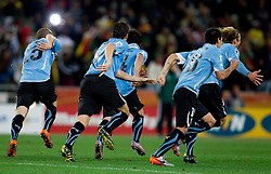 Players of Uruguay celebrate after winning the  penalty shots at the  2010 FIFA World Cup South Africa Quarter Finals football match between Uruguay and Ghana on July 02, 2010 at Soccer City Stadium in Sowetto, suburb of Johannesburg. Uruguay defeated Ghana after penalty shots. (Photo by Vid Ponikvar / Sportida)
