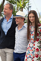 Andrew Lowe, Ed Guiney, Raffey Cassidy at the The Killing of a Sacred Deer  film photo call at the 70th Cannes Film Festival Monday 22nd May 2017, Cannes, France. Photo credit: Doreen Kennedy