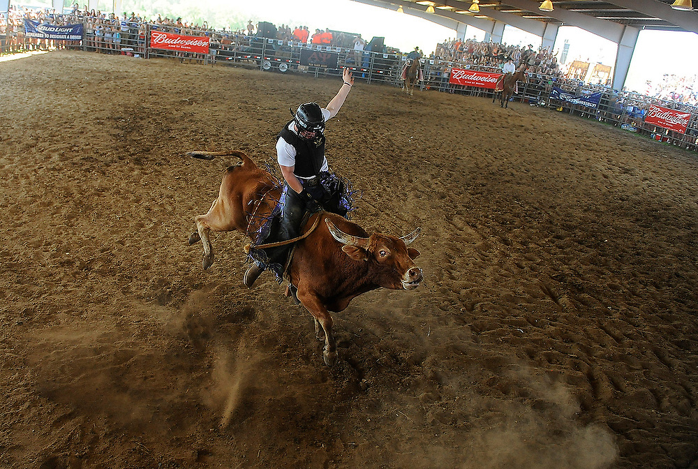 Bull riding at the Alpha Psi Rodeo in Auburn, Ala. on Saturday, April 12, 2014.<br /> Zach Bland