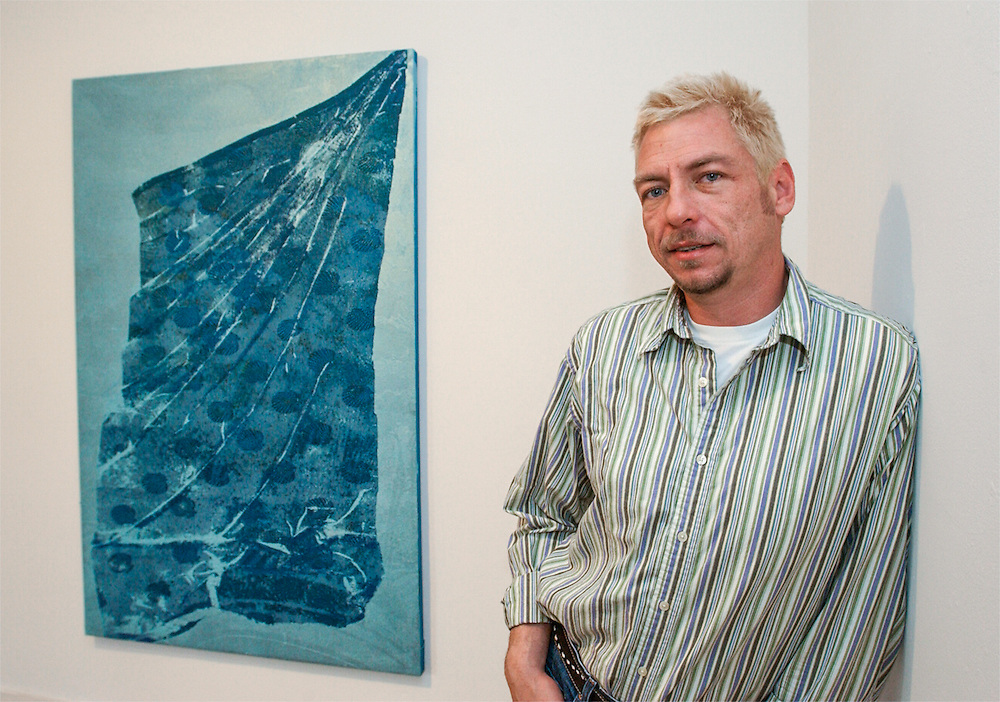 Sala Diaz' Chuck Ramirez stands next to a lace painting by artist Mark Flood.01/05/2016 175335 -- San Antonio, TX - © Copyright 2016 Mark C. Greenberg