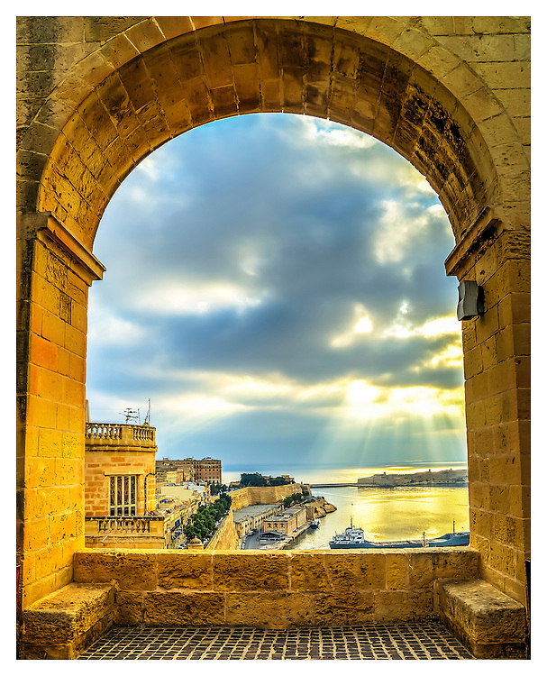 upper barrakka gardens Valletta Malta, looking through one of many arches, with a view to the Mediterranean sea.