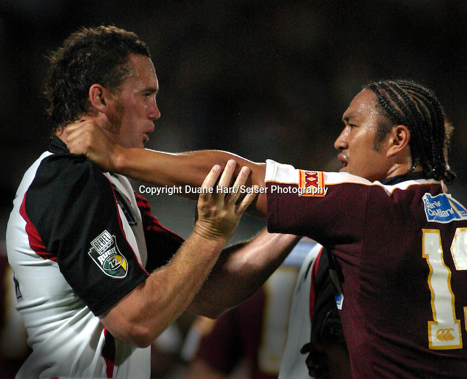 6 March, 2004. Ballymore, Brisbane, Australia. Rugby Union Super 12. Crusaders v Reds. Caleb Ralph and Junior Pelesasa. The Crusaders won the match, 20 - 17.<br /> Pic: Photosport